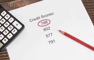 788 points Credit Score result with calculator on wooden table
