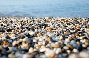 A beach of colourful pebbles at the shore of Black Sea, in Evpatoriya, Crimea
