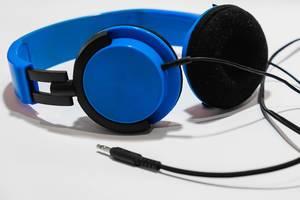 A blue headphones on white surface.jpg