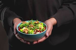 A bowl of fresh healthy food in women