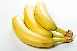 A branch of fresh ripe bananas on a white background (Flip 2019)