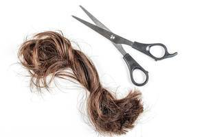 A-bundle-of-cut-hair-with-scissors-on-a-white-background-haircut-change-concept.jpg