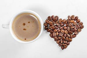 A Cup of coffee and a heart made of coffee beans (Flip 2019)
