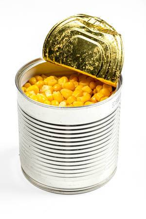 A jar metal can with sweet corn on white