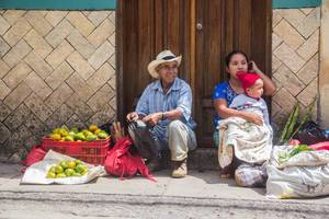 A Man and a Woman Selling Mandarins.