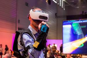 A man plays Exodus Burned with an complete VR equipment at Digital X in Cologne