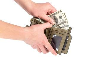 A man puts dollars in an open wallet (Flip 2020)