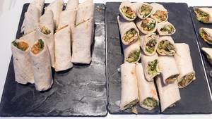 A pile of wraps with different ingredients