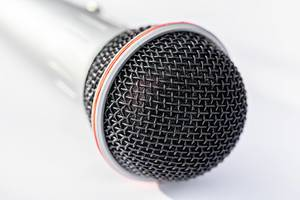 A professional microphone in close up on white background