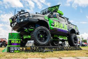 "A ""Hulk"" themed monster truck at a local car show"