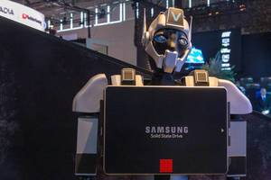 A robot display advertises Samsung Solid State Drive at the Gamescom trade fair in Cologne