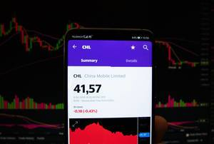 A smartphone displays the China Mobile Limited market value