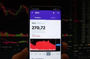 A smartphone displays the Netflix market value