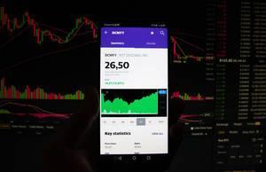 A smartphone displays the NTT DOCOMO market value