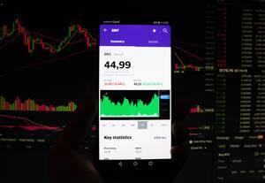 A smartphone displays the Sanofi market value