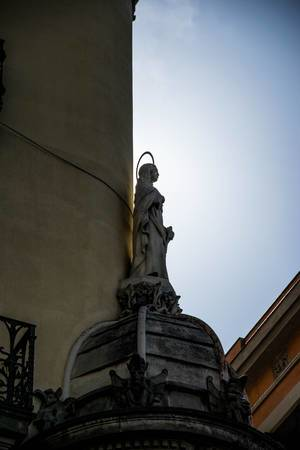 A statue of a saint on a building in Barcelona, Spain