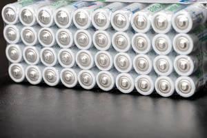 AAA alkaline batteries on a black background (Flip 2020)