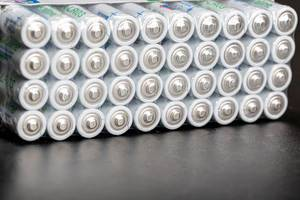 AAA alkaline batteries on a black background