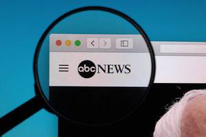 ABC News logo under magnifying glass