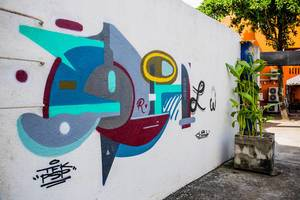 Abstract colourful Graffiti on a white wall
