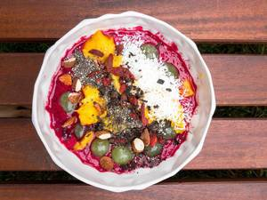 Acai-Bowl of the Day with Almonds, Mango, Chia and Dark Chocolate