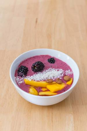 Acai Bowl with Mango, Almonds and desiccated coconut