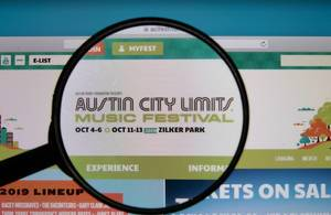 ACL Music Festival logo on a computer screen with a magnifying glass