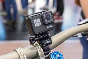 Action camera GoPro Hero 7 black fixed on a bike handlebar