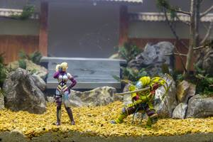 Action figures in a fish tank by Aqua Design Manuel