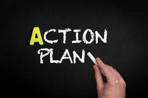 Action Plan Text auf schwarzem Tafel