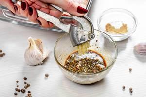 Adding garlic to spicy marinade close up (Flip 2019)