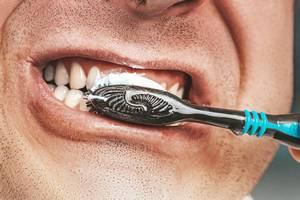 Adult man is cleaning his teeth with brush close up (Flip 2019)