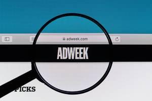 Adweek logo under magnifying glass