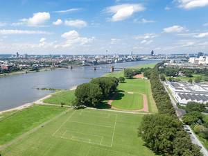 Aerial Drone Shot of Poller Wiesen Park next to Rhein River with Cologne Skyline in the Background
