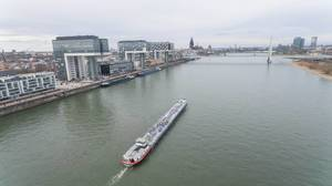 Aerial of ship in front of Kranhaus buildings on rhine river