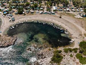 Aerial photo of a small, natural boat harbour