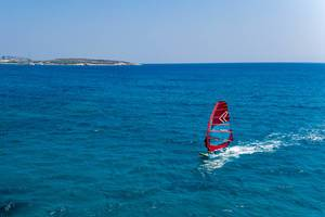 Aerial photo shows a windsurfer on the blue sea off Paros, Greece, in the Aegean Sea