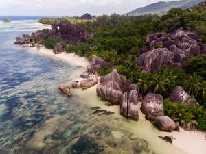 Aerial photography of multicolored granite rocks on Anse Source d