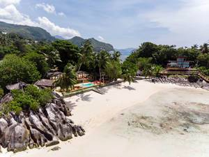"Aerial photography of the villas at Seychelles Island L'Islette - Shooting location for Russian Reality TV Show ""Dom 2"" with beach and ocean view"
