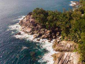 Aerial photography shows waves in front of the bay of Anse des Anglaise near Port Launay in Mahé, Seychellen