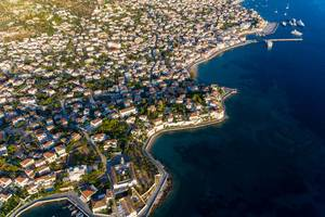 Aerial picture of Agios Nikolaos church and ferry bridge of the green island Spetses, Greece, in the Myrtoan Sea