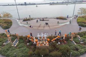 Aerial picture of people at Navy Pier sea bridge, decorated with skeletons and pumpkins for Halloween season