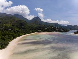 aerial picture of Port Glaud Beach with Morne Seychellois National Park of Mahé Island in the Indian Ocean