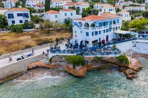 Aerial picture of Restaurant Cielo Mar and Havana Club with an open-air bar at the rocky shore of Spetses