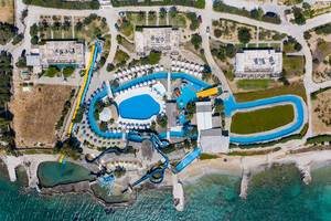 Aerial picture of the Aqua Paros Water Park on a greek Island, with pool and waterslides at the Mediterranean Sea