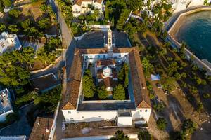 Aerial picture of the mediterranean church and former monastery Agios Nikolaos at the shore of Spetses, Greece