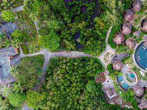 Aerial shot of small trail between Constance Ephelia Resort and its spa area in Mahé, Seychelles