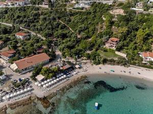 Aerial shot of the beach and surroundings in Afitos, Greece