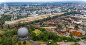 Aerial view of a large construction site with various cranes on Maarweg in Cologne Ehrenfeld, Germany, next to the railway tracks