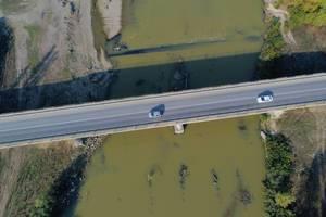 Aerial view of bridge over Arges river, Romania (Flip 2019)
